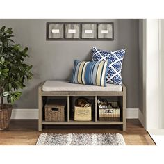 Keep your entryway clear of clutter with the stylish and practical Avenue Greene  Entryway Storage Bench.  Featuring three cubbies for storage and a cushion for comfort.
