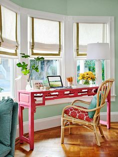 pink desk, aqua wall