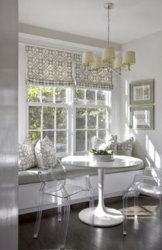 Beautiful dining nook with window seat.  Dreamy roman shades and matching cushions.  #romanshades #windowseats