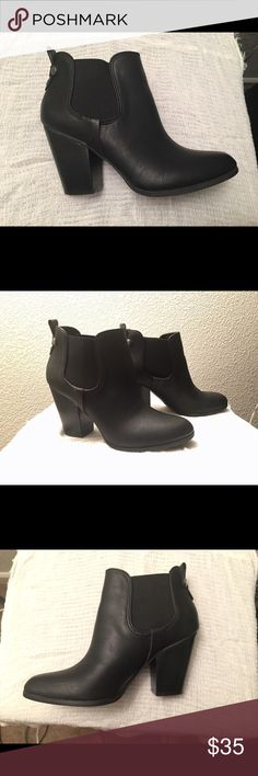 Brand New Black Booties Only worn once so in pretty great condition. Some small silver embellishments on the back. Stretch fabric on the sides makes for a very comfy fit around the ankles. I don't know if it's real leather or not but it feels soft. Must have classic boot! Carlos Santana Shoes Ankle Boots & Booties