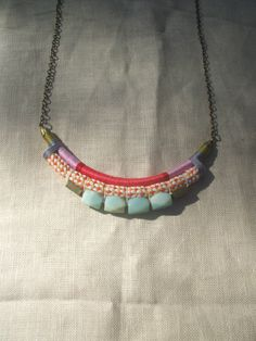 The FRIDA Necklace--Color Study No.21 featuring Hues of Coral, Orange, with Blue Amazonite Beads and Brass Findings. $54.00, via Etsy.