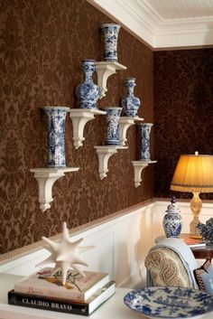 Blue and white accents in brown and white room ~ Alex Papachristidis