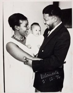 Lot 402 ALFRED KUMALO, (SOUTH AFRICAN, 1930-2012): WINNIE AND NELSON MANDELA WITH ZINDZI MANDELA, 1961, SILVER GELATIN PRINT, SIGNED AND DATED 5.12.96 IN THE IMAGE BY MANDELA, INSCRIBED MR & MRS MANDELA ON THE REVERSE BY KUMALO unframed the plate 18,5cm by 24,5cm R 120 000 - R 200 000
