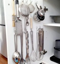 Organize your kitchen for cheap with these dollar store kitchen organization ideas. From DIY spice racks to pan storage hacks, there are organizing ideas for every inch of your kitchen on a budget. Small Kitchen Storage, Diy Kitchen, Kitchen Things, Kitchen Ideas, Kitchen Hacks, Kitchen Inspiration, Kitchen Designs, Cooking Utensils, Kitchen Utensils
