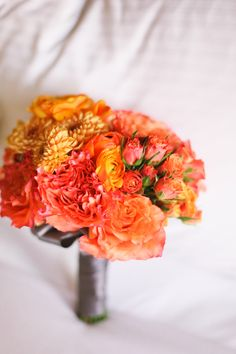 Beautiful bouquet for elegant white, grey, and orange wedding; photos by Adrienne Gunde Photography | junebugweddings.com