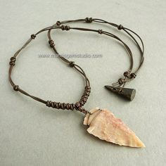 A tribal-inspired leather choker necklace which I carefully handcrafted with a natural Jasper stone hand-knapped arrowhead in a natural shade. I wire-wrapped the stone in hand-antiqued solid copper to