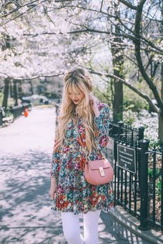 Floral Peasant dress or black floral urban outfitters tank, white jeans and turquoise or pink purse, dark wine lipstick
