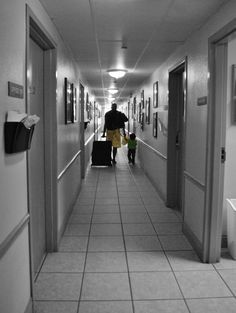 Never be afraid to start over. It's a chance to rebuild your life the way you wanted all along. A father and daughter take their belongings to their newly assigned room at Providence House.