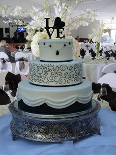 Black Diamond wedding cake, black and white rolled fondant, jewels, glitz, pearls, scrolls and drapes  www.cakedesigners.net