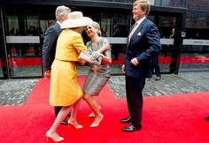 Commemoration of the bicentenary of the battle of Waterloo.  Queen Maxima attempting to kiss Queen Mathilde--she's well defended.