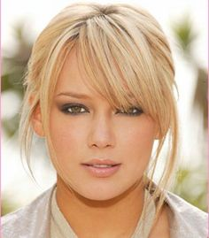 Side-swept bangs for heart-shaped face