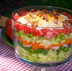 This delicious salad is always a welcome addition to the buffet table for family gatherings, bring-a-dish buffets and summer picnics. Inspired by a classic Southern favorite, this layered all-Ameri…