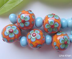 http://www.linakhan.com/aitami-orange-and-blue-psychedelic-flower-beads/