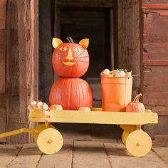 Cheerfully adorable two-pumpkin Halloween kitty.