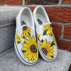 These are Vans Slip On shoes featuring hand-painted Sunflowers! Done free-hand without the use of stencils. This design looks best on natural or pastel colored Vans (or other canvas shoes). Pictured are both White/White and Birch/White Vans. I have six color options available but can make