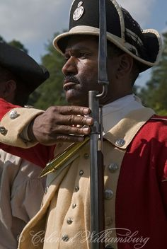 African Americans in the military. Wearing a British uniform during the American Revolution.