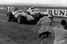 Juan Manuel Fangio, in a Maserati 250 F, duelling through a turn with Stirling Moss, Vanwall VW5, 1958 France