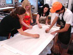 BIG INK students hand printing a woodcut print.