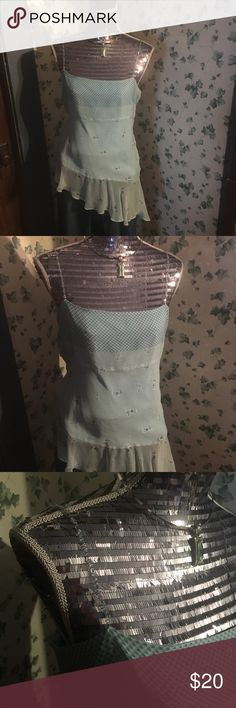 I.C.E. silk sheer blouse with beaded straps Asymmetrical 💯 silk sheer baby blue blouse with beaded spaghetti straps by I.C.E. NWOT. Very alluring. ICE Tops Blouses