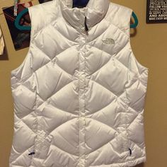 North Face 550 Vest White Vest from North Face that is basically brand new. Only worn 5 times this past winter because it has gotten too big for me. The inside is a dark blue. It has small amount pilling shown in last photo North Face Jackets & Coats Vests