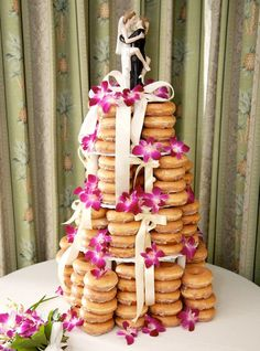 Donut wedding cake ... or any other event. Lol look at the cake topper!!