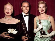 Presenter Bette Davis, Best Actor Marlon Brando for On the Waterfront and Best Actress Grace Kelly for The Country Girl