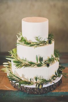 Simple wedding cake for a fall or winter wedding. The touch of greenery adds an earthy touch without going hippie!
