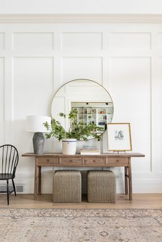 Love this beautiful entryway with its oversized round mirror, rustic console table, vintage rug and board and batten wall treatment | home | style | Studio McGee Decor, House Inspiration, House Design, Home And Living, Interior, Studio Mcgee, Wall Treatments, Entryway Decor, Home Decor