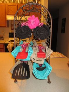 Wine rack with kitchen utensils and kitchen towels- bridal shower