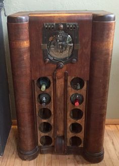 Old radio repurposed into a wine bottle holder
