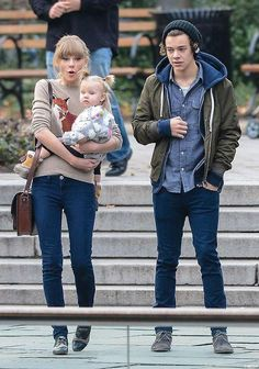 SHES HOLDING LUX!!!! GIVE US BACK OUR BABY!!!!!! NOOOOO!!! Harry is watching Lux and Lux looks scared.