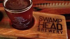 On Tap: Swamp Head Brewery in Gainesville, FL. Offerings include Wild Night Honey Cream Ale, Cottonmouth Belgian Witbier, Stump Knocker Pale Ale, Midnight Oil Oatmeal Coffee Stout, and Big Nose IPA along with many different seasonal and limited release beers.