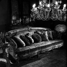 Excellent example of a dark, #Goth couch with chandelier