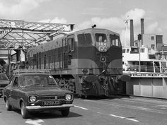 A train, a Ford Cortina cross the Clontarf Bridge with the boat The Killarney in the background Cork City Ireland, Love Ireland, Old Pictures, Old Photos, Street Run, Old Irish, Buses And Trains, Black N White Images, Locomotive