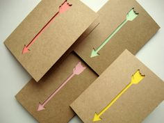 A set of four, hand-cut arrow note cards in four different colors: tangerine, mustard, pink, and mint green.