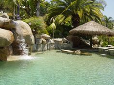 http://www.dickoatts.com/wp-content/uploads/2013/05/Amazing-Rocky-Pool-Waterfall-Thatched-Gazebo-Simple-Backyard-Designs-915x686.jpg