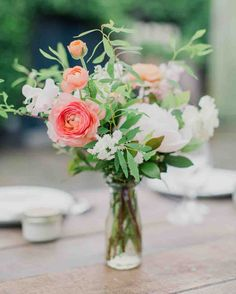 """To create a """"romantic garden""""atmosphere, Poppies and Posies createdcenterpieces that matchedthe bride's bouquet.The colorful blooms contrasted with the rustic wooden chairs, barn tables, and industrial lanterns. Budget Wedding, Chic Wedding, Wedding Table, Floral Wedding, Rustic Wedding, Wedding Flowers, Wedding Planning, Wedding Ceremony, Wedding Ideas"""