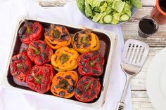Gemista - Greek stuffed peppers is a vibrant dish that smells & looks like summer. It makes a great lunch or dinner, it's effortlessly vegan and gluten-free.