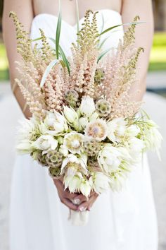 wedding bouquet with astilbe, grasses, scabiosa pods and blushing bride protea Wedding Flower Photos, Bridal Flowers, Flower Bouquet Wedding, Protea Bouquet, Boquet, Bridal Pictures, Pink Bouquet, Scabiosa Pods, Bouquet Images