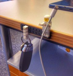 Lego keyfob / desk tidy. No purchase required - just raid your kids' lego stash.