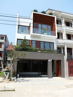 Built by H&P Architects in Hà Tĩnh, Viet Nam with date 2012. Images by Nguyen Van Tho. No47 House is located in Ha Tinh city, Middle Vietnam. By utilizing top lights as well as placing small green-courtya...