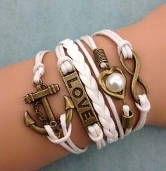 5745e0b37d Items similar to White Infinity Love Heart Pearl Anchor Leather Brass Gold  Charm Bracelet - Confetti Creation on Etsy