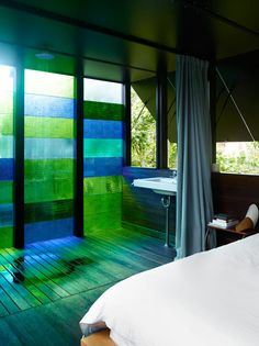 absolutely love this idea.. could maybe use some colored plastic sheets and clear glue on french glass doors as a cheap way to use this idea..