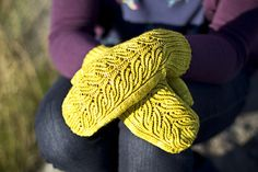 Meristem features a botanical motif of sprouting leaves. The mittens begin with a ribbed cuff worked in the round that transitions into the Meristem pattern at the back of the hand, while continuing in ribbing on the inner wrist for a more comfortable fit. The palm of the hand is worked in stockinette stitch and a gusset is used to create extra fabric for the thumb specifically for right and left hands. The botanical motif continues to the tip of the fingers, where the stitches are decreased…