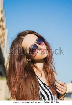 Fashion lifestyle portrait pretty woman in the sunglasses posing in the city summer, sunset light, street fashion - stock photo #fashion #fashionphoto #girls #women #streetfashion #people #brunette #posing #beauty #trend #look #designer #young #hair #makeup by Elizaveta Soldatenko