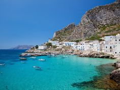 With a population of around 450 and a total area of 2.25 square miles, Levanzo is the smallest of the three Aegadian Islands, off Sicily's western coast—and it is worth a visit for anyone trying to get away from all the noise of modern life. The town of the same name is the launching point to explore the whole island, best experienced by following the extensive hiking trails as they pass through fertile agricultural plains, and gently climb towards peaks that offer stunning views of t...