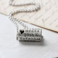 A stunningly simple and elegant tube design, personalised with your choice of words and cut out hearts.  The tube pendant is handcrafted in sterling silver and can be personalised with your own special words, names, places or dates, making it the perfect gift to celebrate a wedding, birthday, anniversary, special occasion or birth.  You can have up to 8 letters on each 'line', which will be offset so we can make space to add hearts or stars, and we will cut out little hearts into the design…