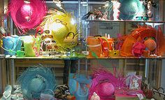 Summer color bright #eyewear display using summer accessories: straw hats, flip glops, pails and buckets. Premier Optical Window Display Summer 2008