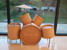 This is a drumset made completely of cardboard I made for my 3d Foundations class. The pieces are all connected (minus the drumsticks). Favorite band Tool logo on front for extra flair (copyright T...