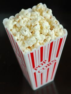 Make your own microwave popcorn using a brown paper bag.